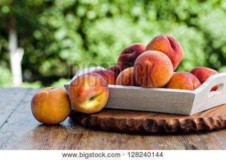fresh peaches on wood background