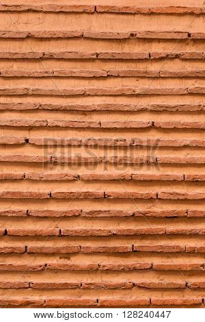 An abstract background image of a brick wall in Morocco.