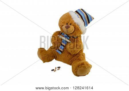 isolate the macro children's toy teddy bear in a scarf with tablets takes temperature a mercury glass thermometer