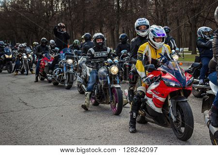 Moscow Russia - April 23 2016: Motorcyclists open the spring season. The group of motorcyclists on the road. Russian riders. Focus on the foreground.