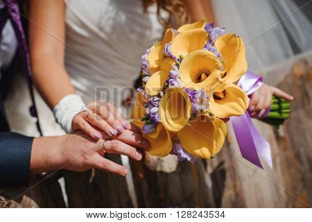 beautiful colorful fresh flowers wedding bouquet in bride's arms