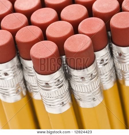 Close up of group of pencil erasers.