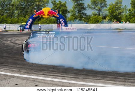 Lviv Ukraine - Juny 7 2015: Rider Dmytro ILLYUK on the car brand Nissan overcomes the track in the championship of Ukraine drifting in Lviv.