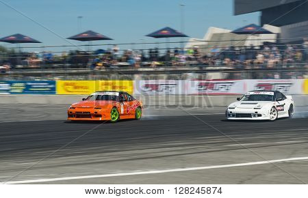 Lviv Ukraine - Juny 7 2015: Unknown riders on the car brand Nissan overcomes the track in the championship of Ukraine drifting in Lviv.