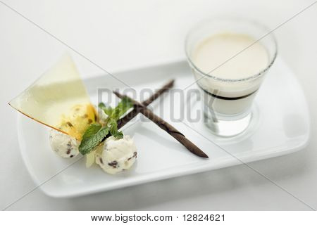 Still life of gourmet dessert with professional presentation.