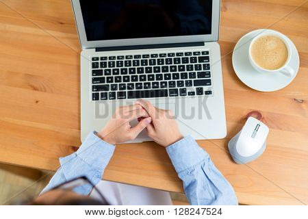 Top view of woman watching laptop computer