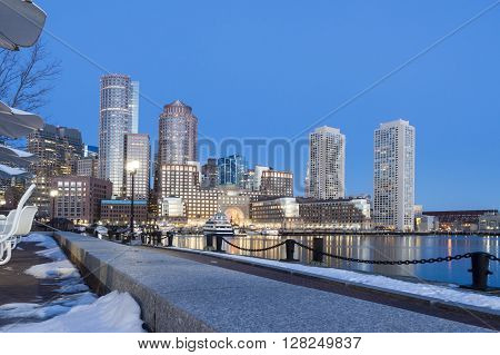 Sun lights Rowes Wharf on winter morning along Boston waterfront