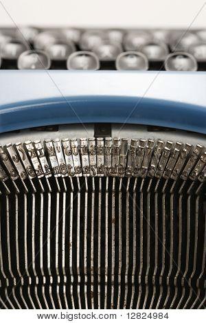 Close up of typewriter typebars.