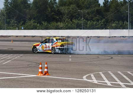 Lviv Ukraine - Juny 6 2015: Rider Volodymyr Borovitsky on the car brand BMW overcomes the track in the championship of Ukraine drifting in Lviv.