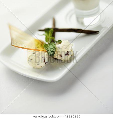 Still life of gourmet dessert with professional presentation.