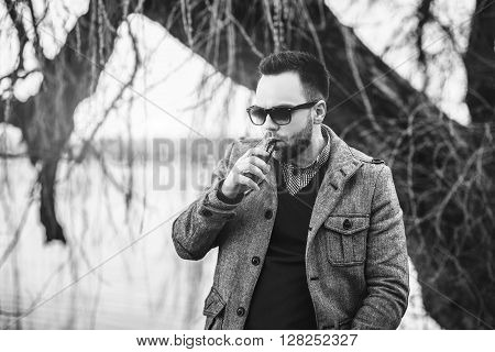Man With Beard  Vaping Outdoor Electronic Sigarette