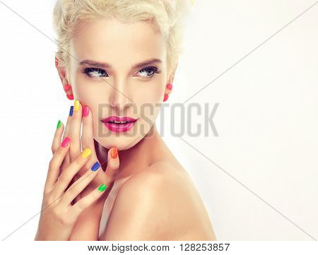 Beautiful model with colorful makeup and nail Polish . Stylish blonde with bright makeup and colored nail Polish . 