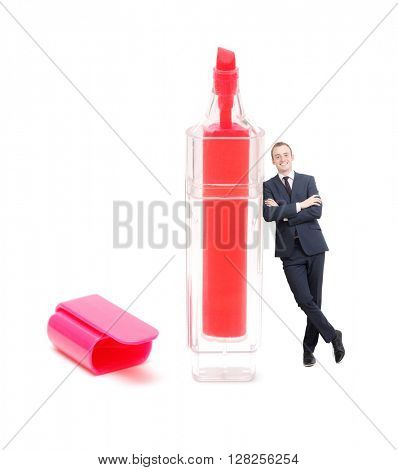 Businessman leaning on marker on white