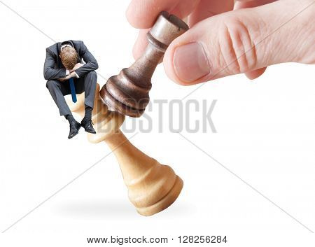 A businessman on a chess piece