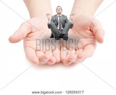 Businessman meditating on white