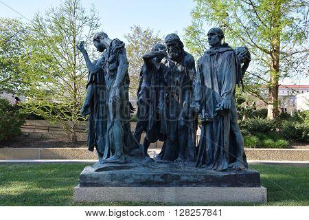 WASHINGTON, DC - APR 16: Les Bourgeois de Calais sculpture by Auguste Rodin at the Hirshhorn Sculpture Garden in Washington, DC, on April 16, 2016. In 2013, the Sculpture Garden drew 645,000 visitors.