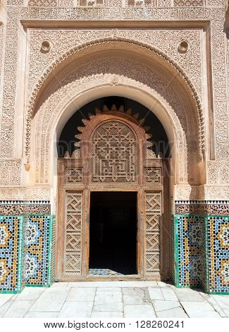 MARRAKECH MOROCCO - APR 29, 2016: Entrance door to the inner court of the Ben Youssef Madrasa. A former Islamic college in Marrakech Morocco.