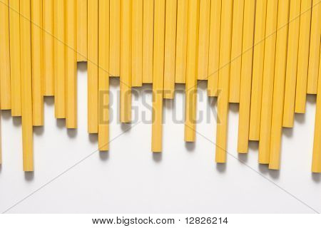 Uneven row of unsharpened pencils.