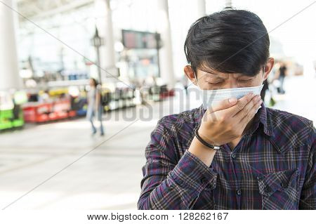 Asian young man feeling unwell at outdoor