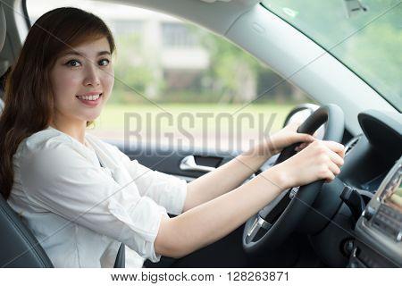 young beautiful asian girl in car