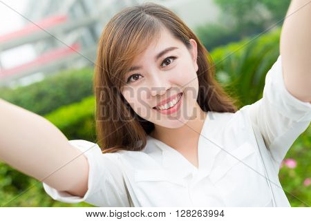 young beautiful asian girl with phone in school