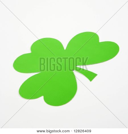 Single green paper shamrock on white.