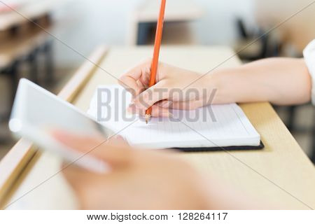 young beautiful asian girl student with tablet in classroom