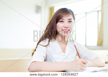 young beautiful asian girl student in classroom