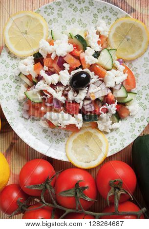 Shopska salad with white cheese, tomato, cucumber, pepper, onion and olives