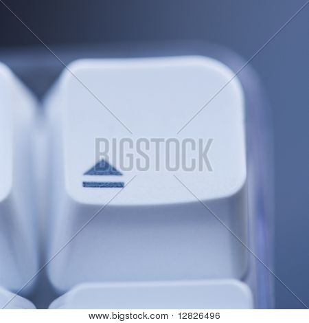 Close up of eject key on computer keyboard.