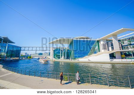 BERLIN, GERMANY - JUNE 06, 2015: Marie Elisabeth Lueders house in Berlin is a beautiful modern construction, surrounded by a river