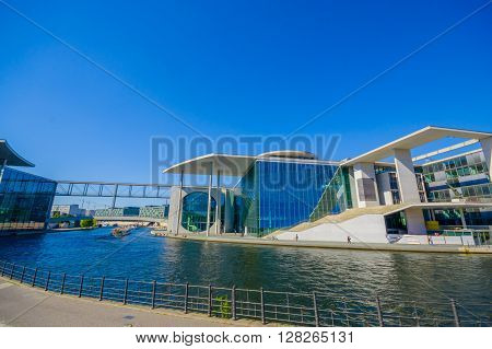BERLIN, GERMANY - JUNE 06, 2015: Modern construction in Berlin city, glass and blue color fusioned. Parliament library,