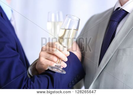 Two homosexuals are going to drink champagne