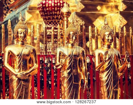 Vintage retro effect filtered hipster style image of gold Buddha statues in Wat Phra That Doi Suthep, Chiang Mai, Thailand