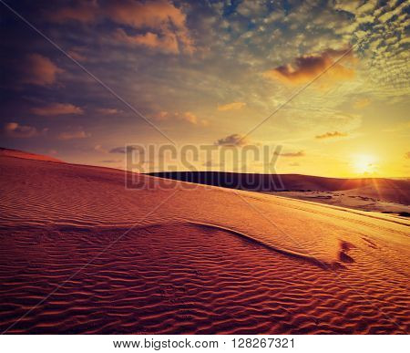 Vintage retro effect filtered hipster style image of desert sand dunes on sunrise, Mui Ne, Vietnam