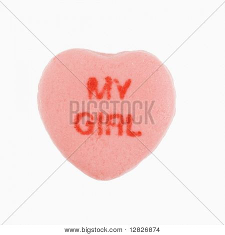 Pink candy heart that reads my girl against white background.