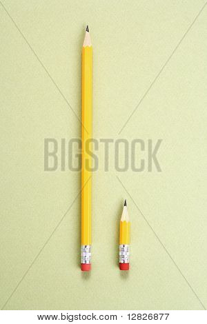 One long pencil and one short pencil placed side by side in comparison.