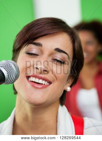 Woman Singing While Closing Eyes