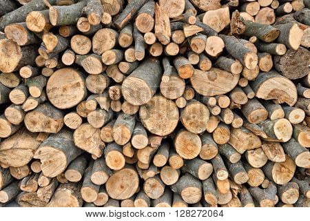 Pile Of Wood Logs Ready For Winter. Stack Of Firewood As Background