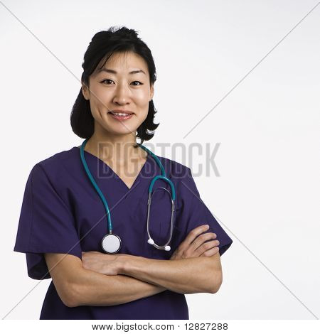 Asian woman doctor half length portrait against white background.