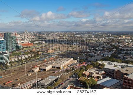 MELBOURNE, AUSTRALIA - APRIL, 2016 : Bird view of  West Melbourne with Bombardier tram depot and Star Observation Wheel in the foreground in Melbourne, Australia on April 11, 2016