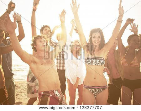 Group of people enjoying a summer beach party.