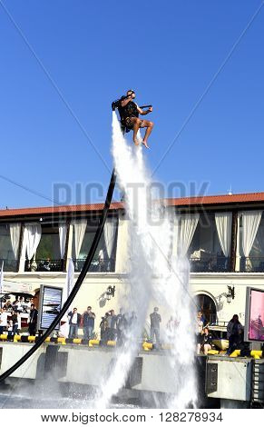 Sochi, Russia, on 2 may 2016. Open, free show of yachts and boats. The performance of the man on a water jet pack. The show is devoted to holiday of spring and peace