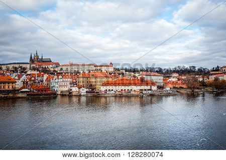 Old Town ancient architecture and river pier in Prague, Czech Republic