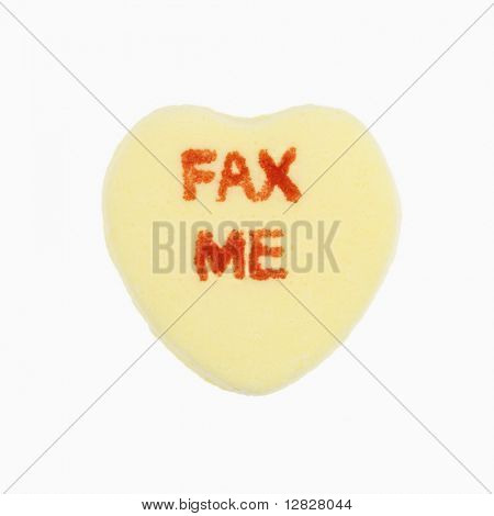 Yellow candy heart that reads fax me against white background.
