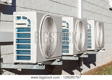 Three Newly Installed Airconditioning Units Mounted On Wall