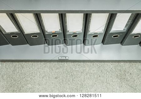 Closeup group of document file in file cabinet on gray carpet background