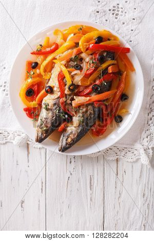 Mackerel In Vegetable Marinade Close-up On The Table. Vertical Top View