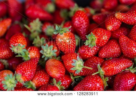 Fresh red strawberries arranged and ready for sale at marketplace. Bio ecological food.