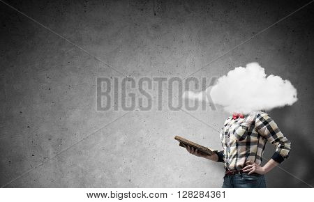 Unrecognizable woman with book and cloud instead of head